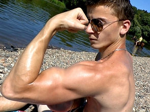 Muscle Flexing on the Beach